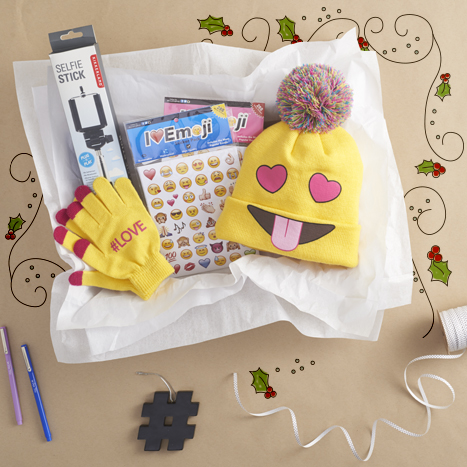 A wonderful gift box featuring emoji stickers, gloves, and a hat from Paper Source.