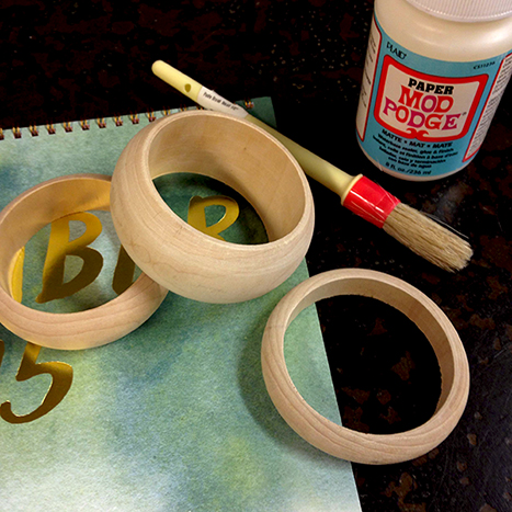Wooden bangles on top of an old calendar