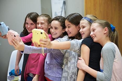 the girls taking selfies