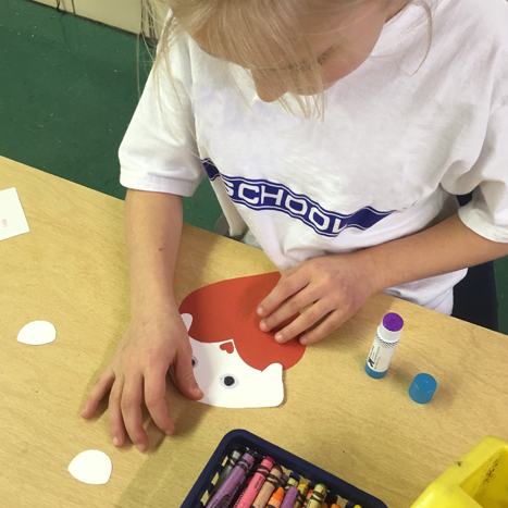 a child making a paper valentine