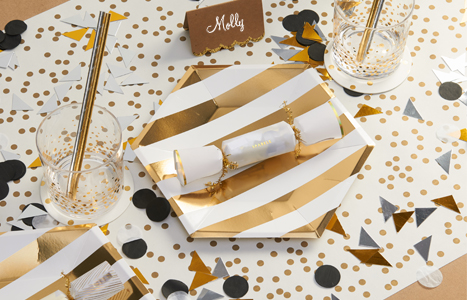 gold and white themed table setting