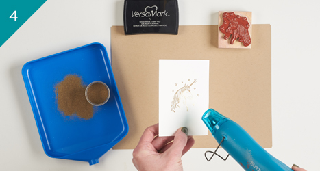 heating up the area with embossing powder using the heat tool