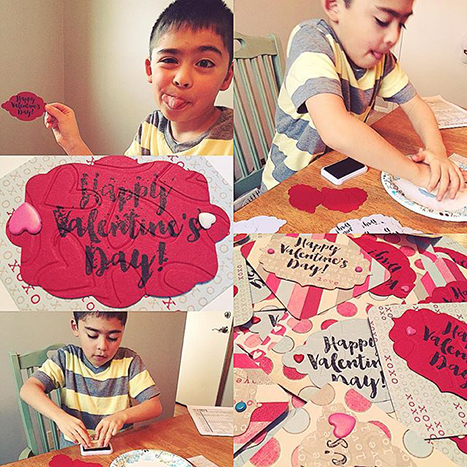 a young boy making valentines