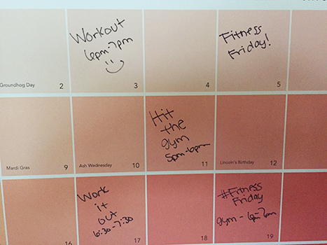 colorful wall calendar with workouts penciled in