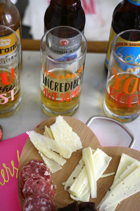 beer in tasting glasses and a snack tray