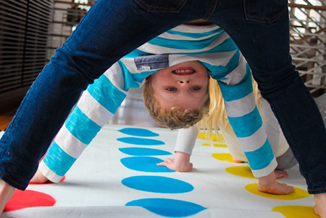 a boy playing twister