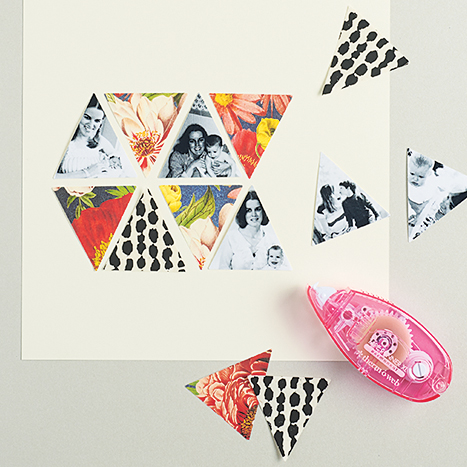 cut out triangles being taped onto white paper