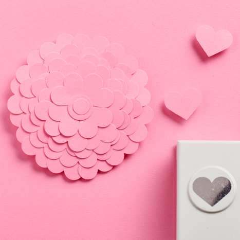 a paper flower made from cut out pink hearts