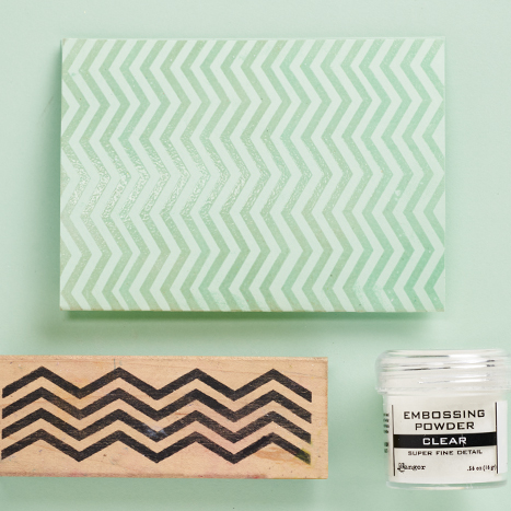a mint colored card with a chevron pattern
