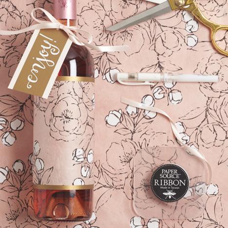 Floral paper on a wine bottle