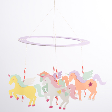 unicorn carousel strung up and hung