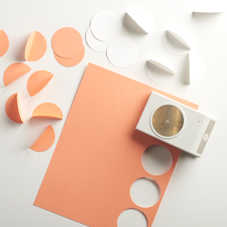 hole punching out colored circles