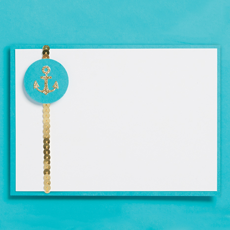 blue card with embellished with sequins and an anchor