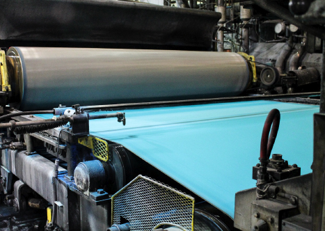 machines rolling out paper