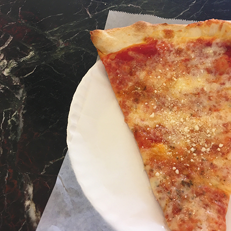 a slice of new york style pizza