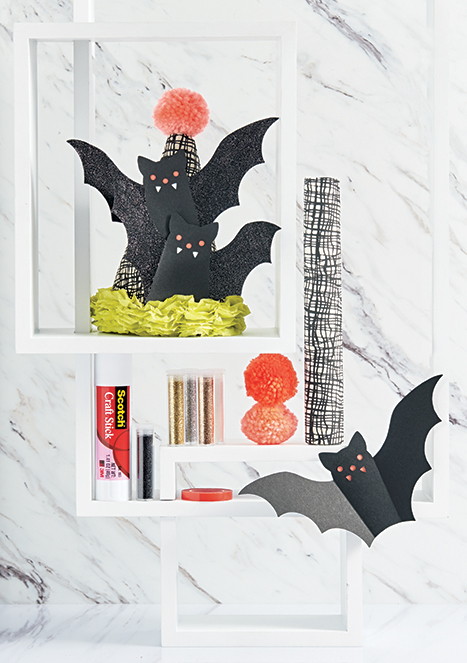 halloween-themed party hat paper bats on it