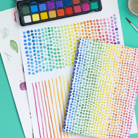 watercolored dots on a planner