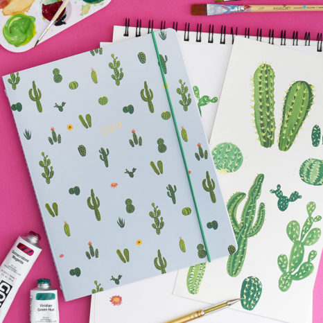 handprinted cacti on a planner